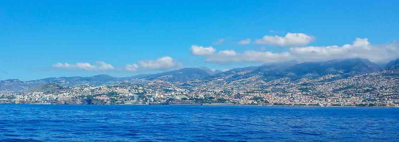 Madeira is a green floating garden of blooms, rises spectacularly from the sea and mysteriously disappears into the clouds.